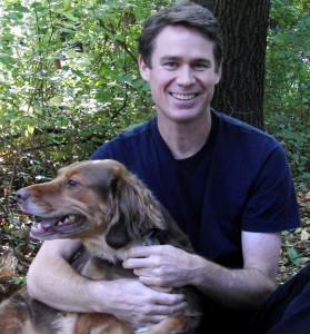 Andy with Mina who is a Viszla-Irish-Setter mix.